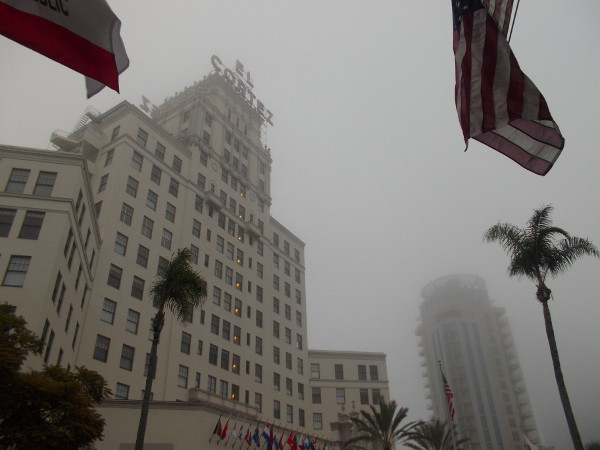 Flags, palm trees and early morning fog on Cortez Hill in San Diego.