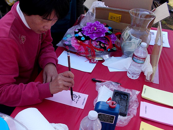 Many displays were at the Chinese New Year event in Balboa Park. This gentleman wrote people's names using Mandarin characters.