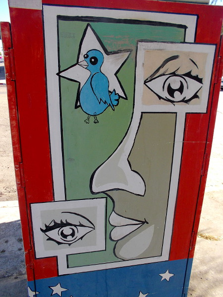 Another side of the creatively decorated utility box.