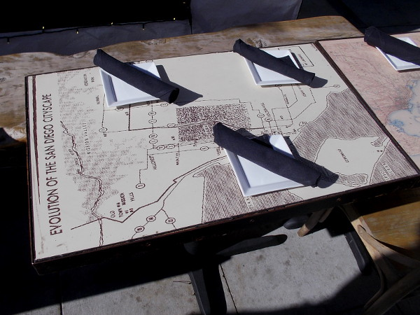 One restaurant, The Patio on Goldfinch, has unique outdoor tables. Your food is placed upon historical maps of San Diego!