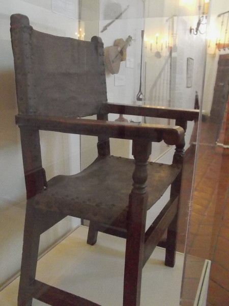 "Leather armchair made in Catalan, Spain in the 17th century. This ""friar's chair"" was part of the original Serra Museum's furnishings."
