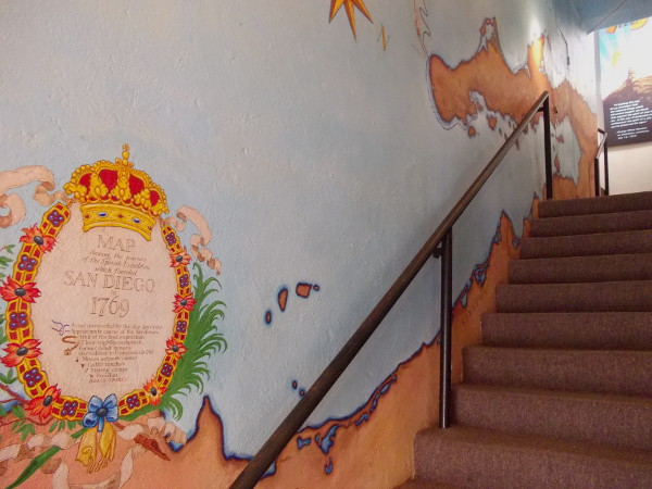Stairs lead up to the Serra Museum's tower. Painted on the wall is a map showing the sea journey of the Spanish Expedition which founded San Diego in 1769.
