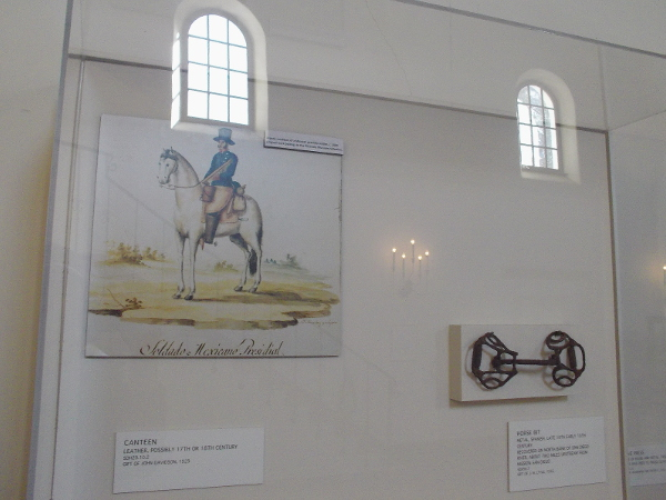 Artistic rendition of a Mexican presidio soldier circa 1830, and a horse's bit.