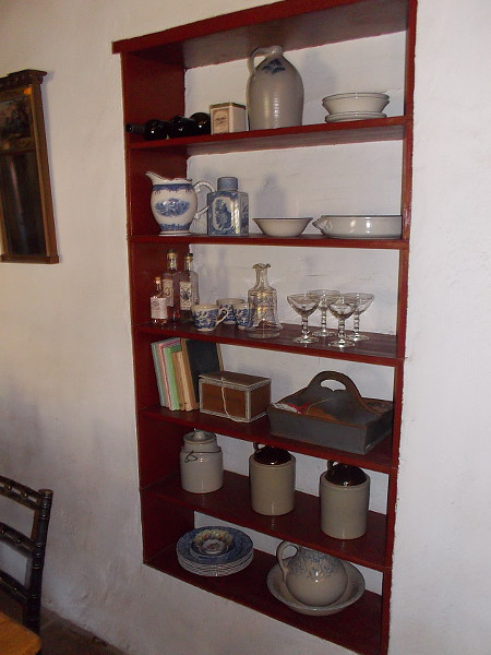 Shelves in the Commercial Restaurant contain old jars, goblets, bowls, bottles, plates and more.