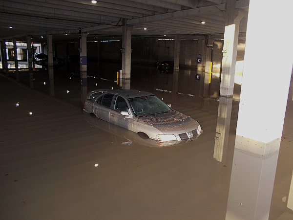 Car deep in the water. The flooded lower level of a Fashion Valley parking garage in San Diego's Mission Valley.