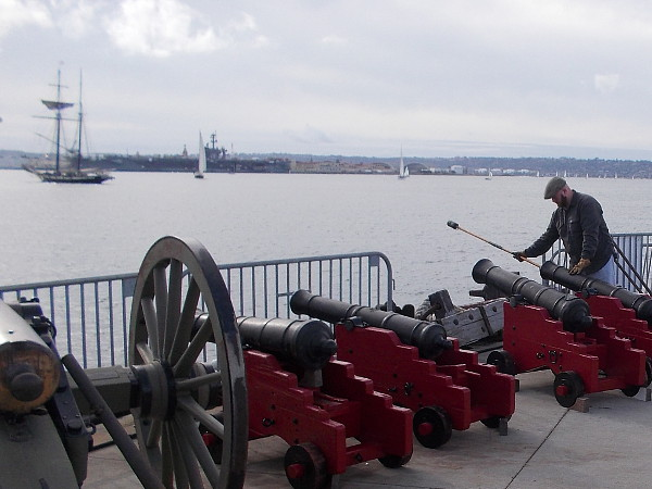 The Maritime Museum employee quickly loads one of the land battery cannons, and gets ready to fire! That pirate won't get away so easily!