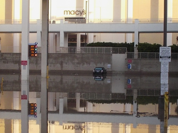 A couple dozen cars were spotted flooded at the Fashion Valley shopping mall. This one was stranded not far from Macy's, which also suffered some flooding inside the store.