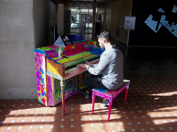 A cool guy plays this public piano at the Central Public Library in downtown San Diego. He heard about this very unique event and came on down to tickle the ivories.