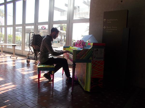 One of ten pianos placed around San Diego for the public to enjoy. Many library patrons coming through the front door were treated to unexpected music!