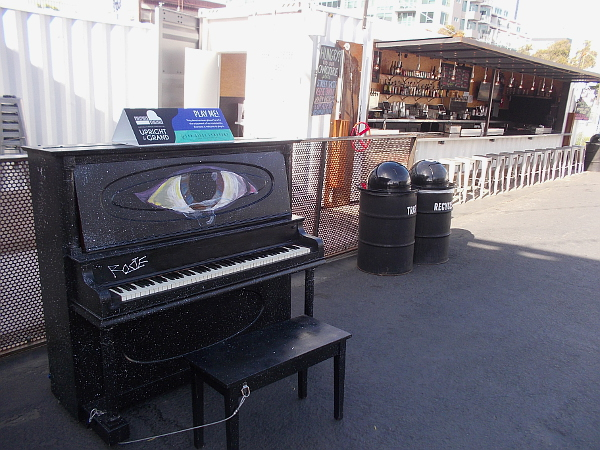 This piano has a big cyclops eye. It sits outside in the Quartyard in San Diego's East Village.