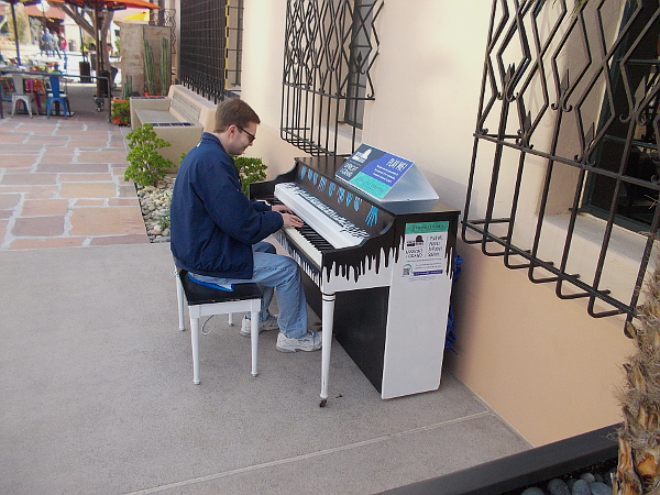 This fellow enjoyed playing this public piano which has been placed at The Headquarters, near Seaport Village.