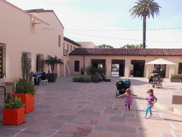 Kids twirl to piano music in the wide courtyard of The Headquarters, which is located in San Diego's old police headquarters.