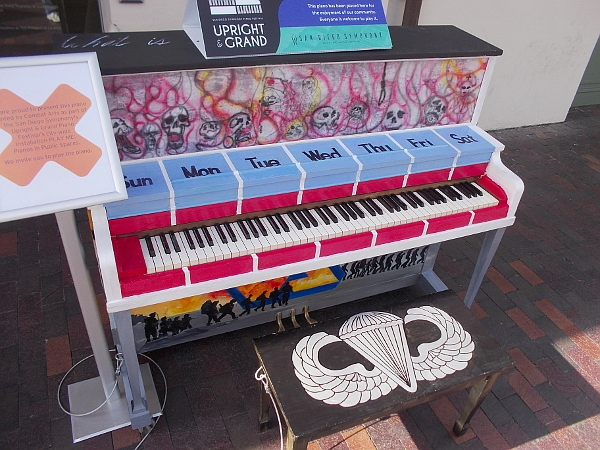 Piano in public for any random passerby to play. Veterans who painted this instrument are part of an art-based museum program to help combat troops recover from PTSD.