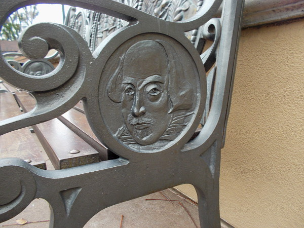 The iconic face of William Shakespeare on the side of a fantastic public bench in Balboa Park's Old Globe Courtyard.
