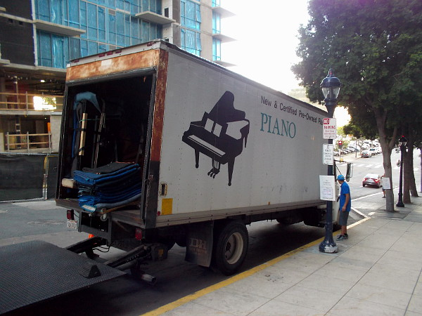 A truck waits to haul pianos away at the backstage door of Copley Symphony Hall.