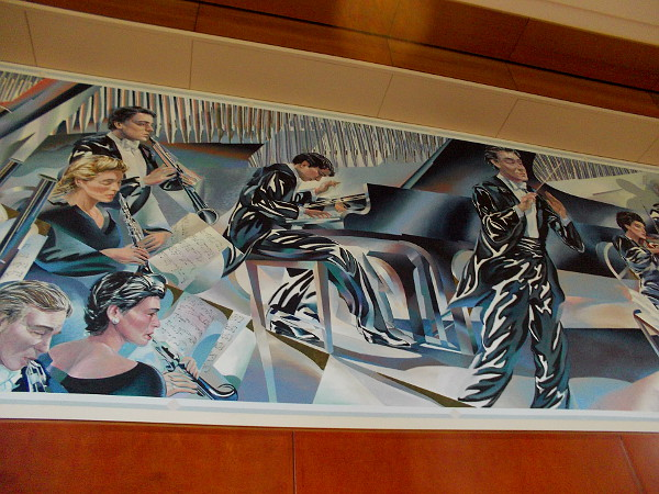 Fantastic mural in lobby of Symphony Towers depicts an orchestra, including a pianist.