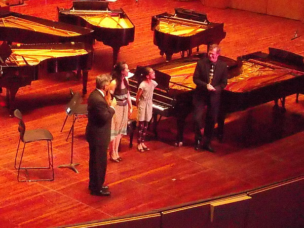 After the first hour's concert is over, the audience applauds narrator Dave Scott and amazing pianists Jessie Chang and Bryan Verhoye!