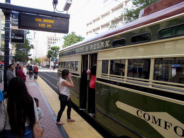 A couple passengers will take a ride on this restored PCC streetcar, of the San Diego Trolley. I joined them!