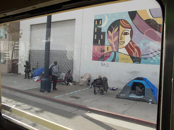 Heading down Park Boulevard, and people camped on the sidewalk. San Diego, unfortunately, contains many homeless.