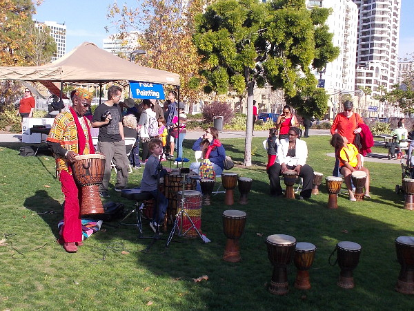 People were enjoying drumming on the grass in Ruocco Park, near Seaport Village.