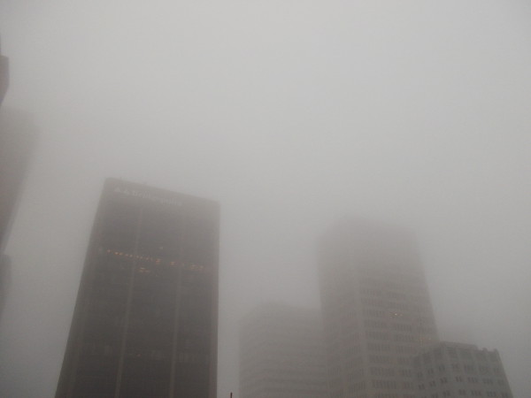 Skyscrapers aren't scraping so much this morning. They are being softly engulfed by the elements!