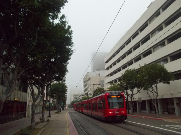 An Orange Line trolley heads down a quiet C Street.