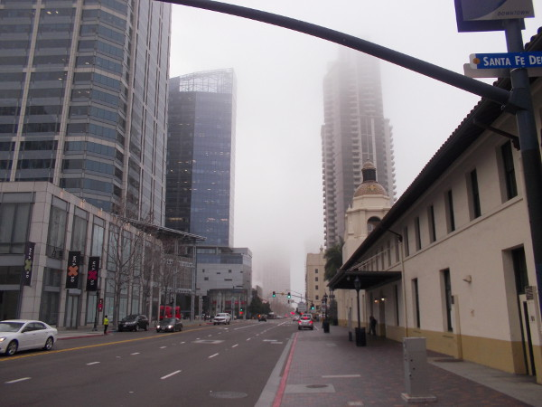 Looking down Kettner Boulevard past Santa Fe Depot and America Plaza into the distant fog.