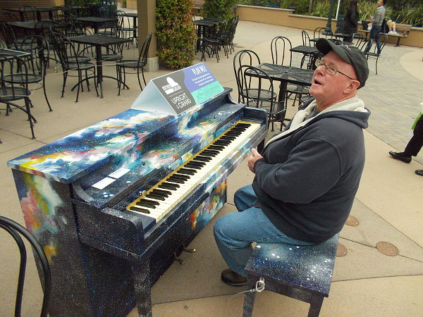 And finally, the magic piano bench. Anybody can sit here and play through January, courtesy of the San Diego Symphony's PLAY ME: Pianos In Public Spaces event.