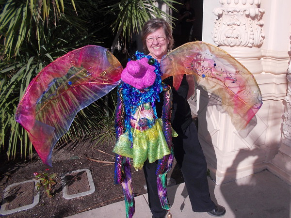 A fairy puppet and smiling puppeteer pose for my camera in San Diego's wonder-filled Balboa Park.