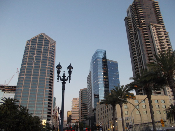High buildings in downtown San Diego change color with every passing minute as my feet and twilight steadily progress.