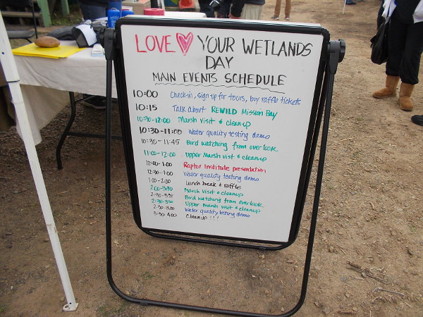 A sign welcomes visitors to Love Your Wetlands Day. Lots of activities included bird watching, a water quality test demo, and a marsh clean-up.