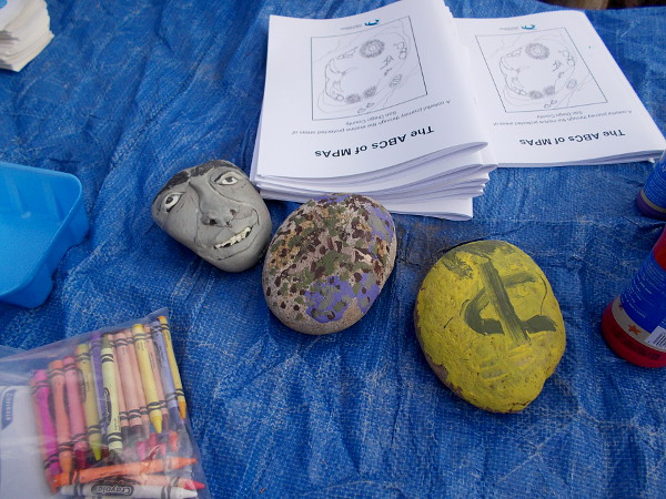 An art project for kids involved creatively decorating stones!