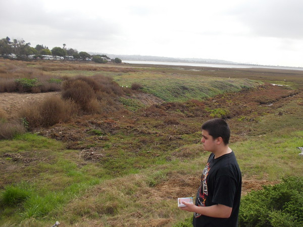Walking over to collect a water sample. The Kendall-Frost Mission Bay Marsh Reserve habitats include coastal sage scrub, south coastal salt marsh, tidal channels, salt flats and mudflats.