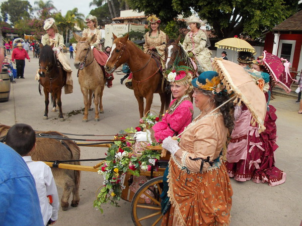 These ladies on horseback and in a fancy miniature donkey-driven cart were being photographed right and left. Wearing elegant frilly dresses and holding parasols, they delighted everybody!