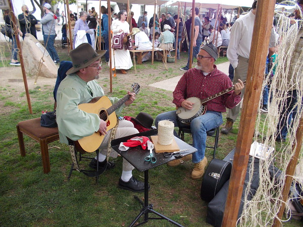 A guitar and a banjo create upbeat frontier-style music