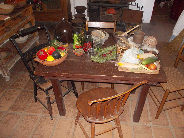 A table full of peppers and vegetables. What life was like many generations ago, in the kitchen of Old Town's Commercial Restaurant museum.