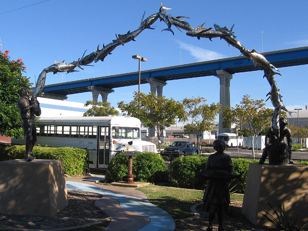 A high arch of gleaming fish seems to rise above the nearby Coronado Bay Bridge. This public art is located in Barrio Logan, near the entrance to Cesar Chavez Park.