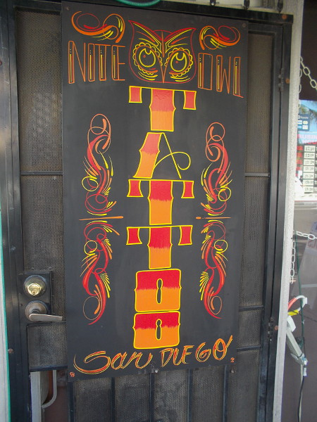 Art on the door of Nite Owl Tattoo San Diego, in Hillcrest.