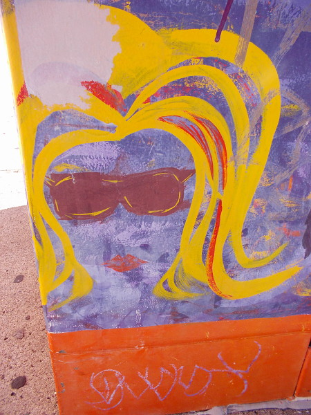 A painted blonde with cool sunglasses.