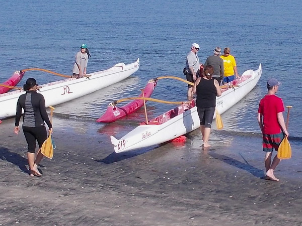 Outrigger canoes ready to be pushed out into the deeper water of San Diego's recreational paradise Mission Bay.