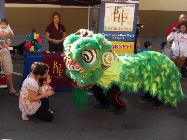 Lion dancer meets small visitor to the 34th Annual 2016 San Diego Chinese New Year Food and Cultural Fair.