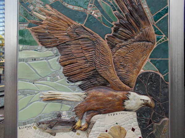 Beautiful handmade mosaic tiles show a Kumeyaay ispa (eagle) in flight.