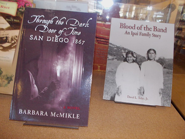 Through the Dark Door of Time: SAN DIEGO 1867, a novel by Barbara McMikle. Blood of the Band: An Ipai Family Story, by David L. Toler, Jr.