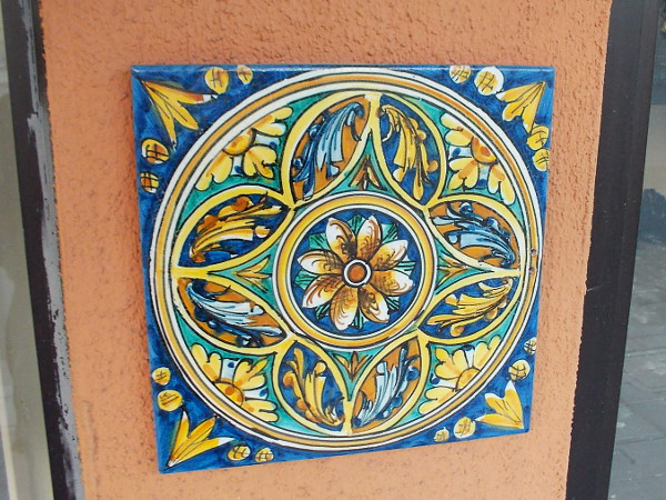 Just a fun artistic tile on a building wall that I noted as I walked up India Street this morning.