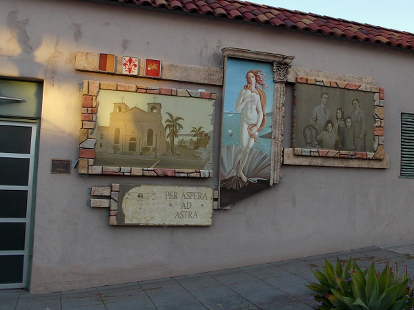 Several murals that together are titled Eredita Italiana. By Yakov Kandinov, 2004. According to a nearby plaque, this is a Precious Cheese Art Mural Project.