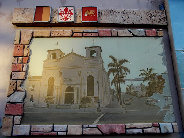 One of the grouped murals depicts the historic Our Lady of the Rosary church in Little Italy.