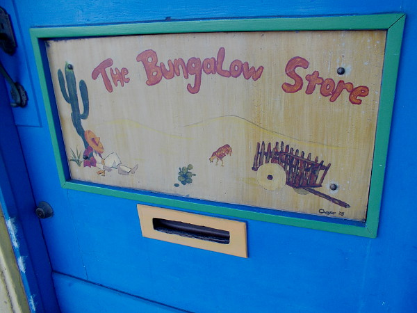 Just a fun sign on a Little Italy antique shop's door. The Bungalow Store.