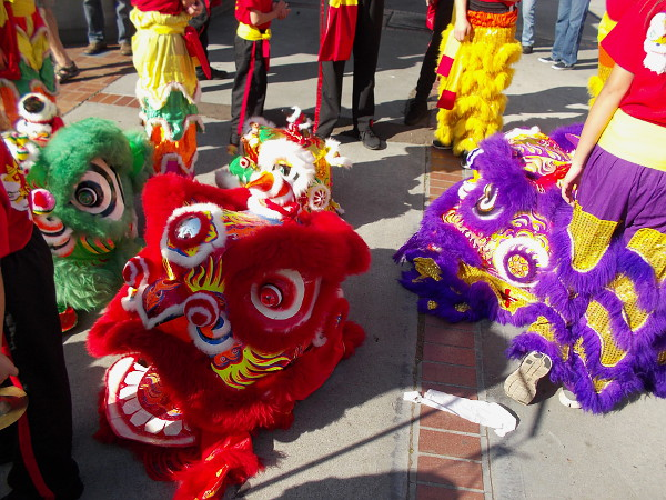The CCBA Lucky Lion Dancers would soon be heading down the street through the crowd.