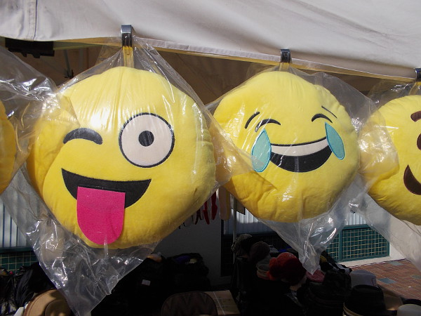 These funny faces were for sale in a vendor's booth. There was lots of Chinese food and a variety of colorful wares for visitors to purchase.