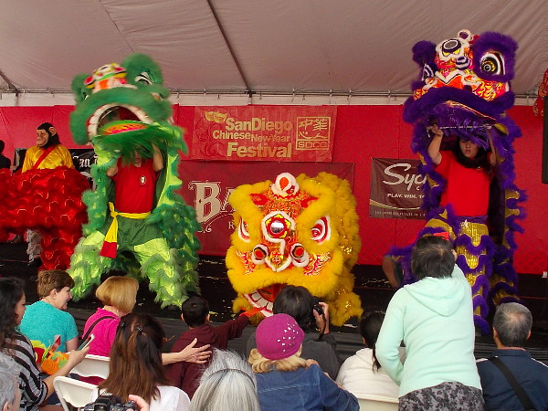 The energetic, exciting lion dance resumed, and people fed the lions red envelopes full of money for good luck!